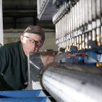 man at work pe perforator machine