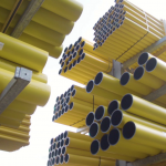 Yellow gas pipes stored in racking